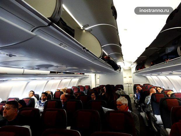 Салон эконом класса Катарских авиалиний